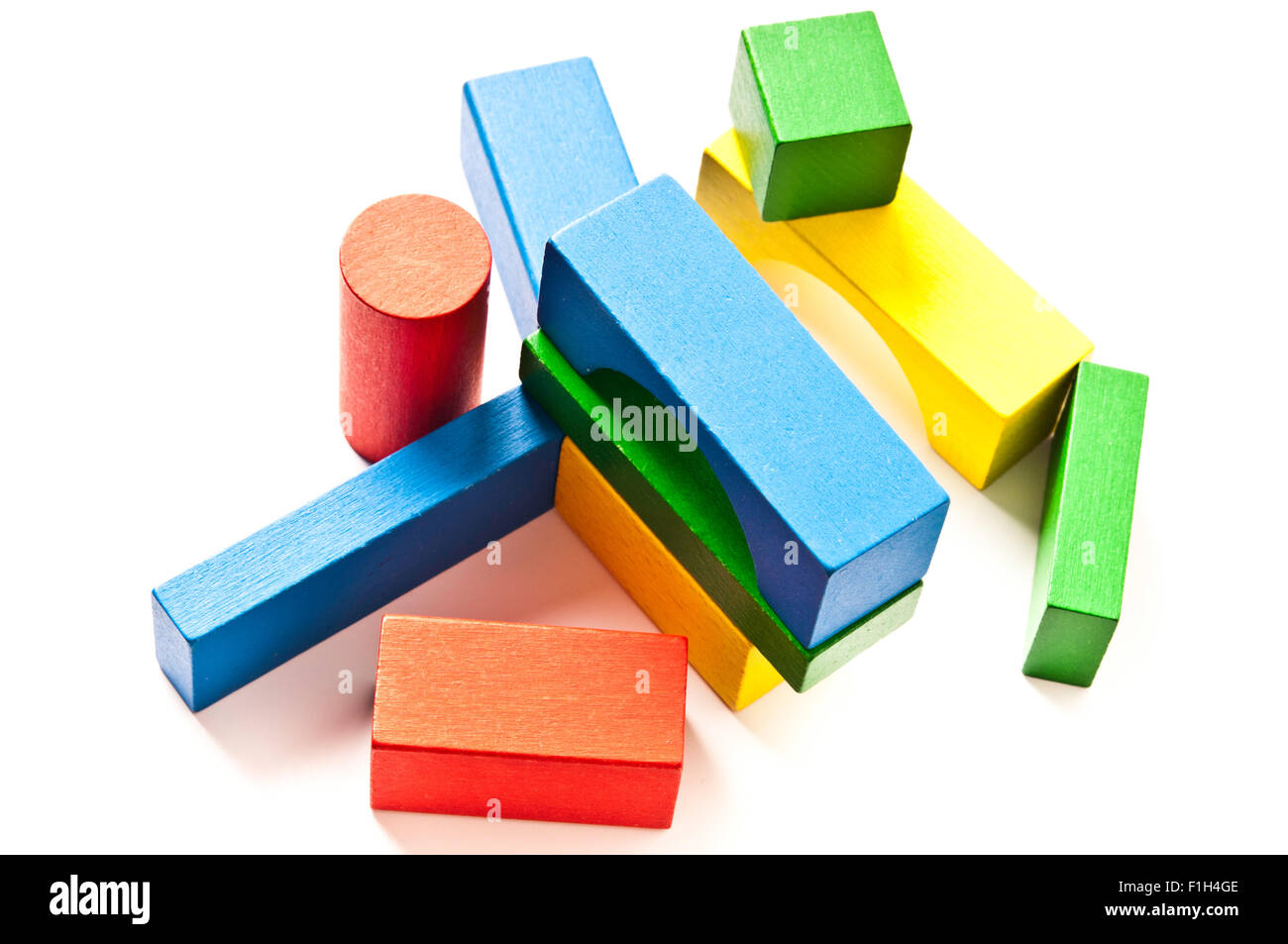 colourful wooden toy construction pieces Stock Photo