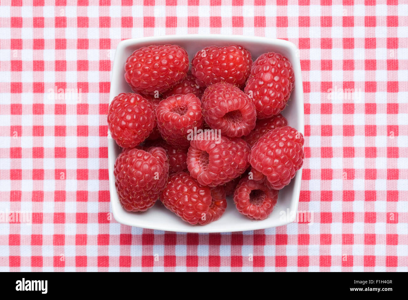 Rubus idaeus 'Autumn Bliss'. Freshly picked raspberries. - Stock Image