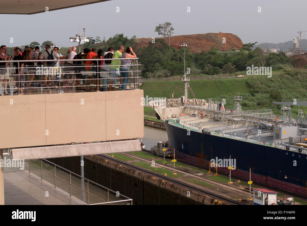 Panama Canal at Miraflores Locks. Ocean shipping, worldwide commerce, logistics, sea industry, ship, boat, people, - Stock Image