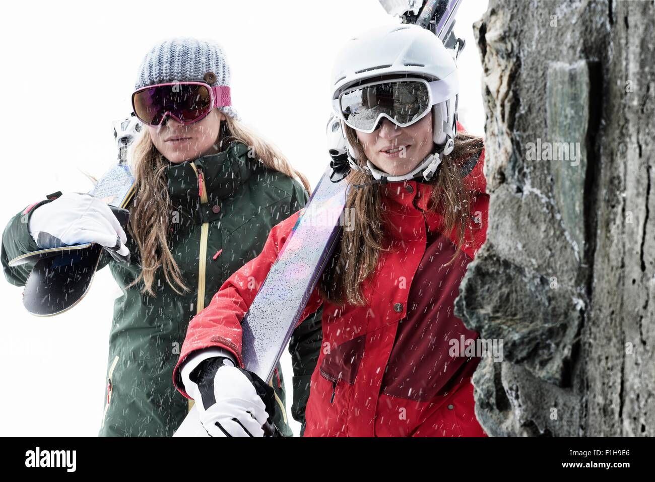 1ed60d87717 Women wearing ski goggles holding skis Stock Photo  87047134 - Alamy