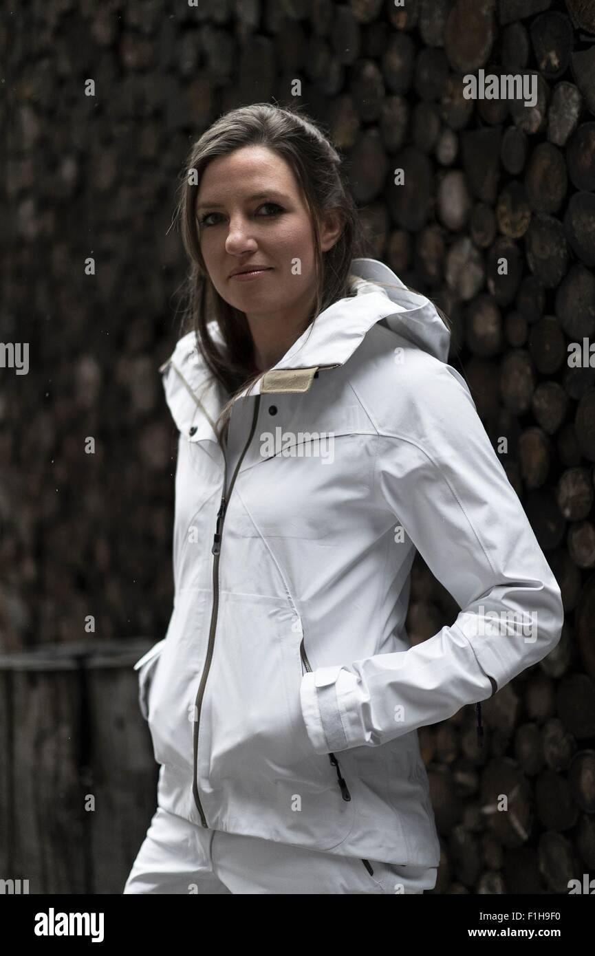 Mid adult woman wearing white coat, portrait - Stock Image