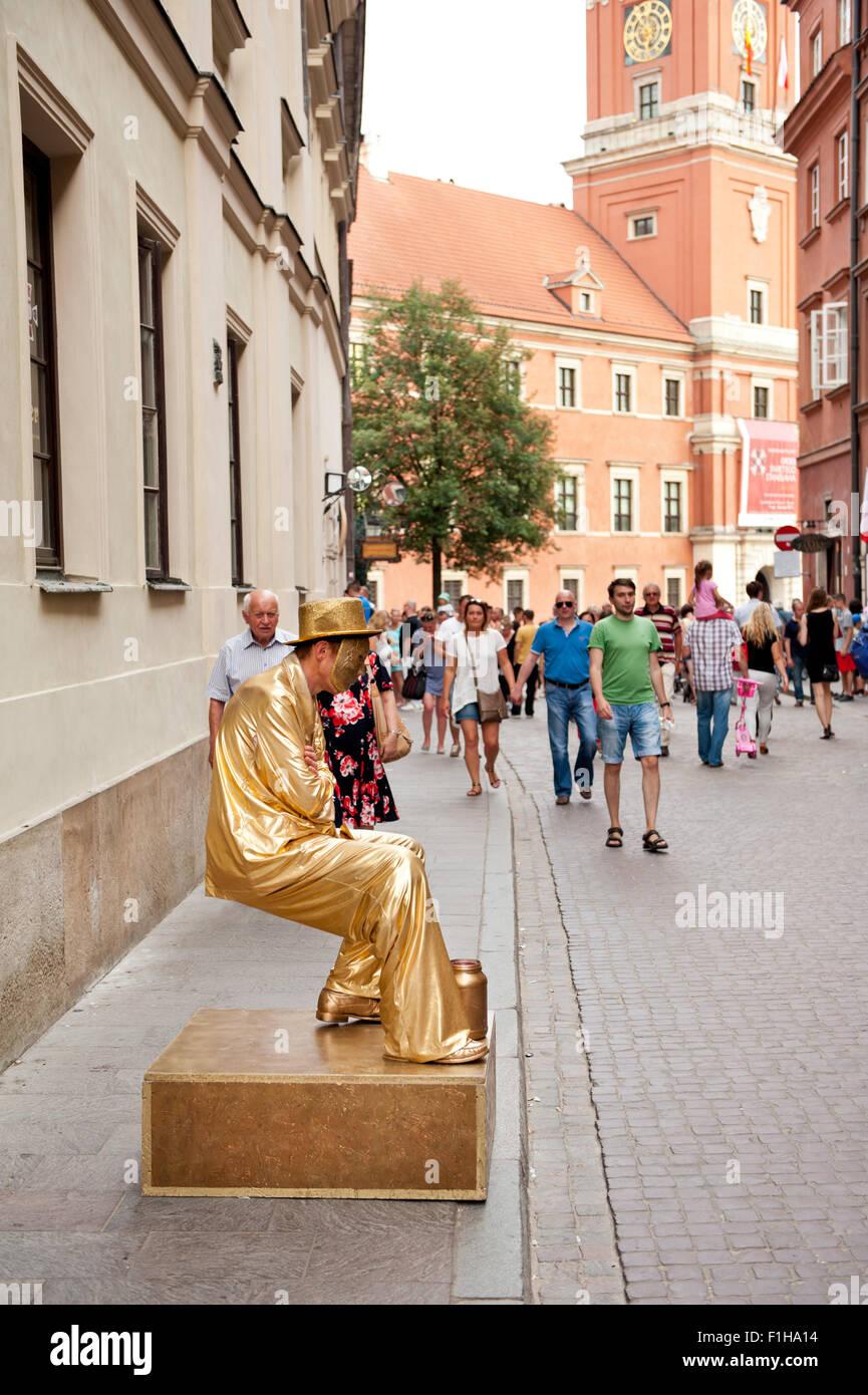Golden man levitation street performer - Stock Image