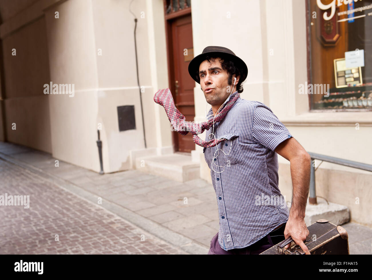 Funny face mime street performer - Stock Image