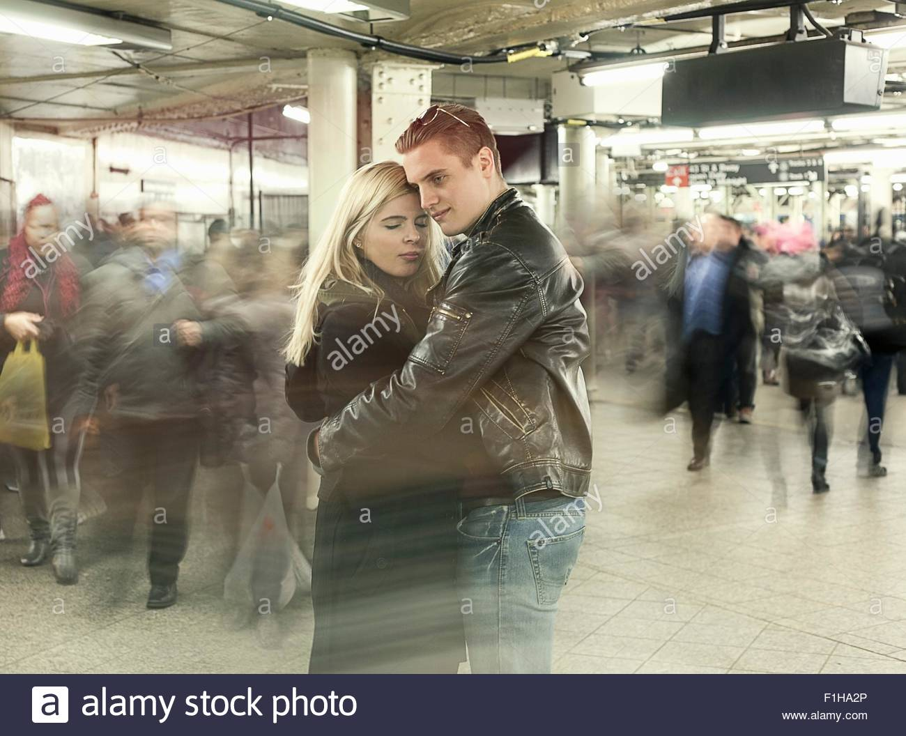 Romantic young couple hugging in New York City subway station,  New York, USA - Stock Image