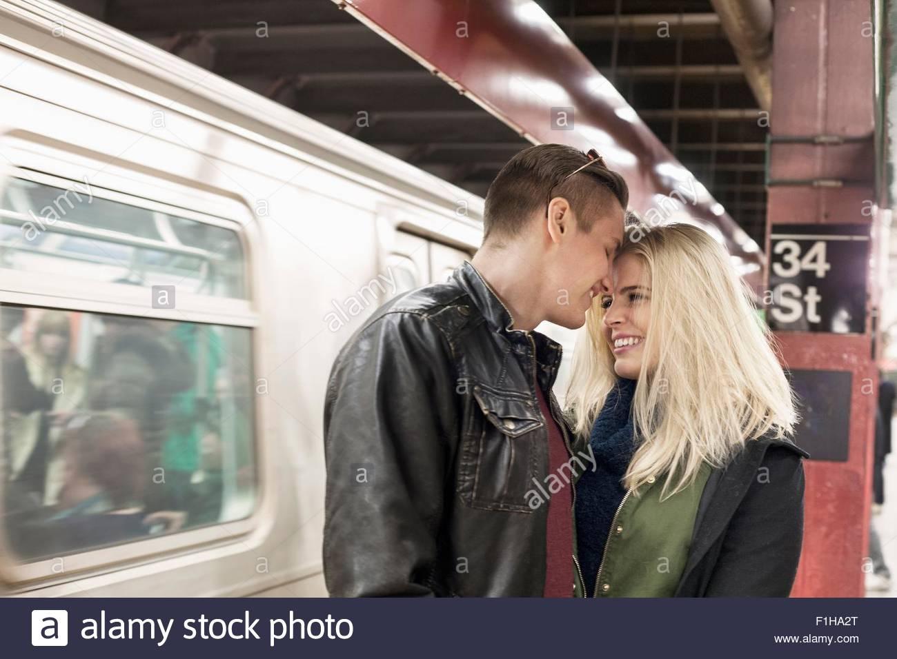 Romantic young couple on New York City subway platform,  New York, USA - Stock Image