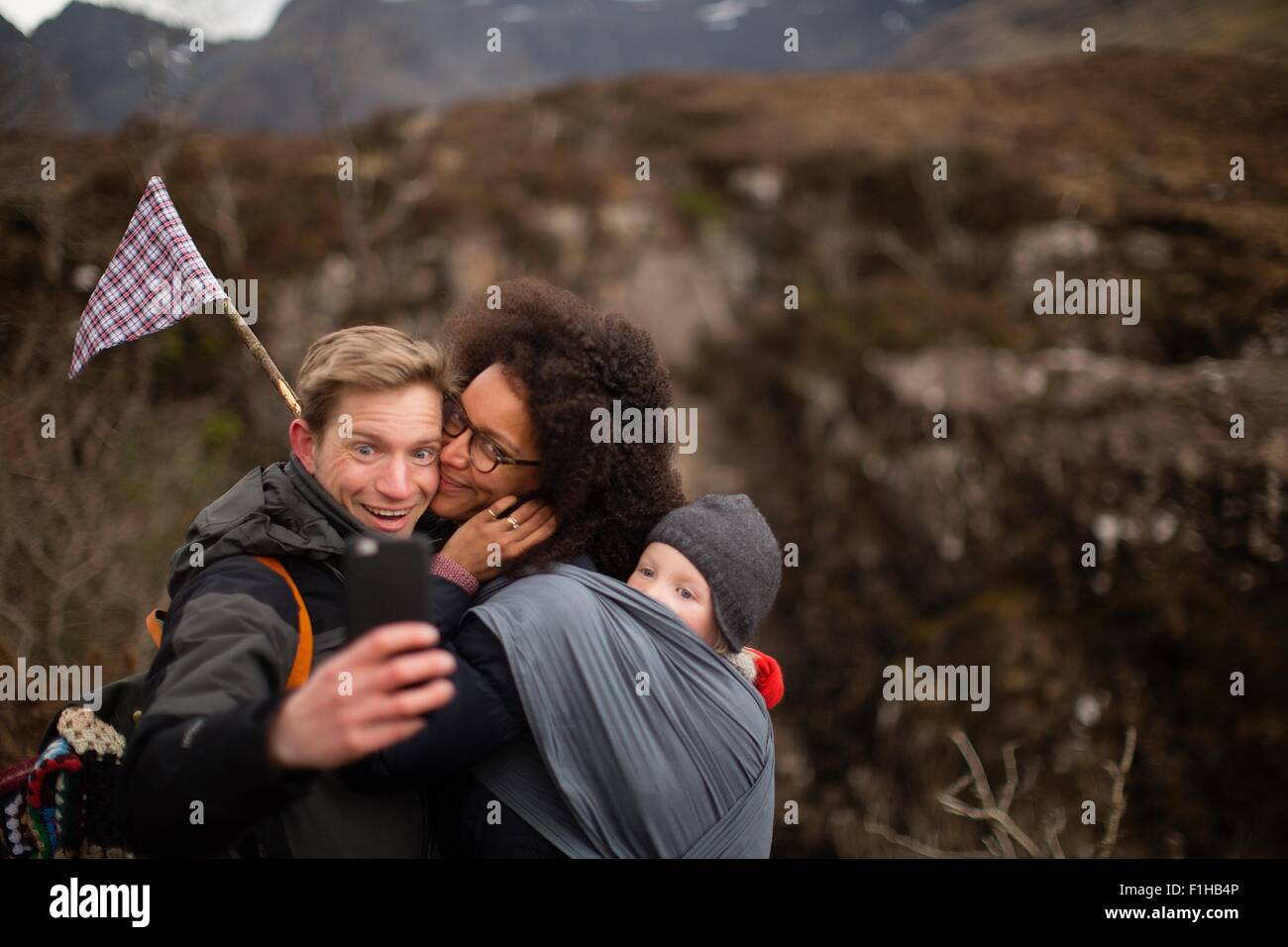 Family photographing themselves on hike - Stock Image