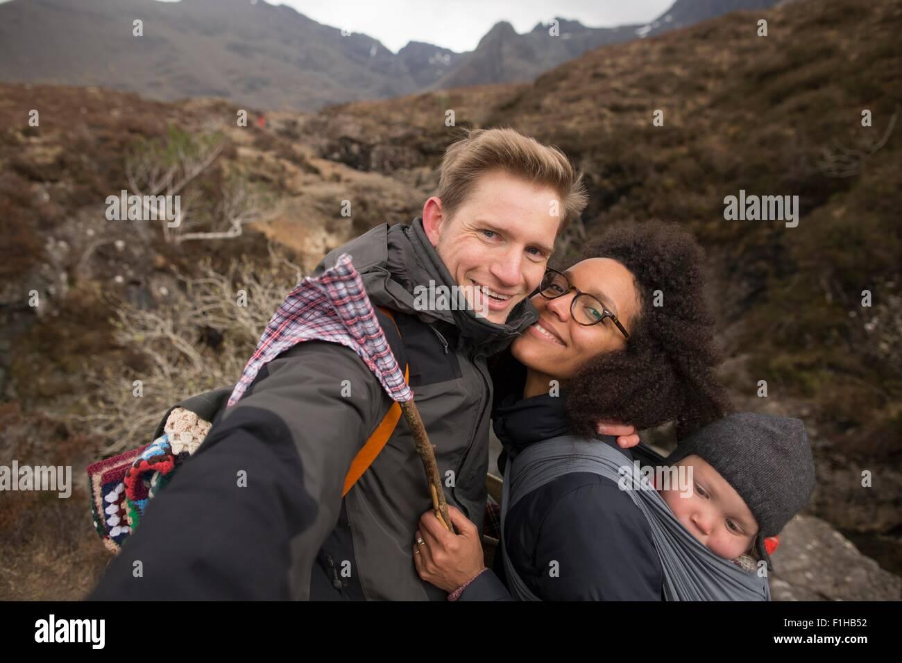 Family on hike, smiling towards camera - Stock Image