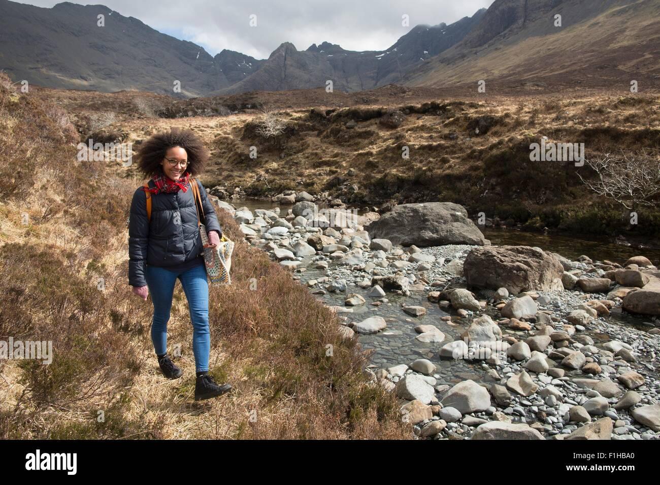 Mid adult woman hiking, Fairy Pools, Isle of Skye, Hebrides, Scotland - Stock Image