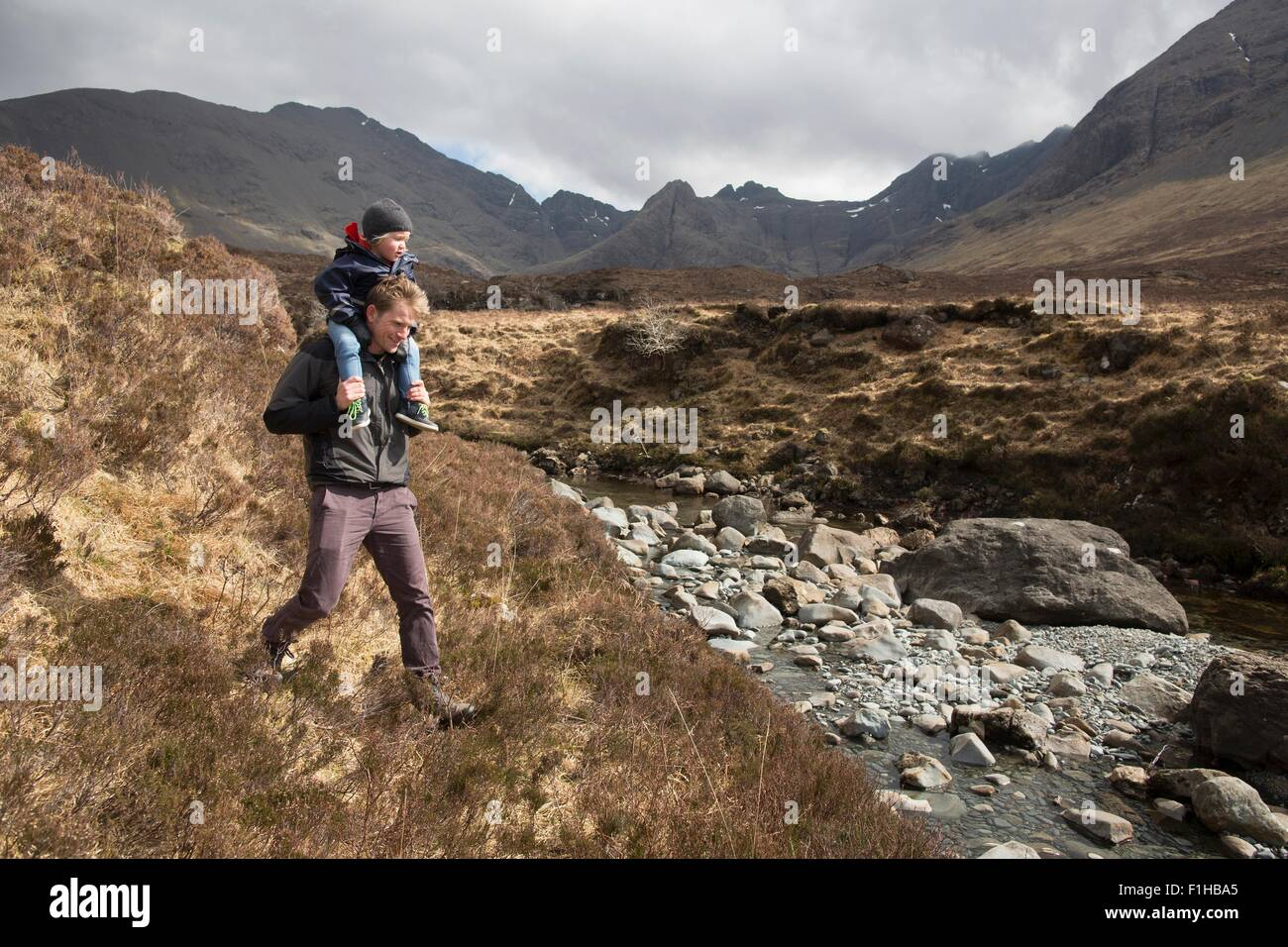 Father and son hiking, Fairy Pools, Isle of Skye, Hebrides, Scotland - Stock Image