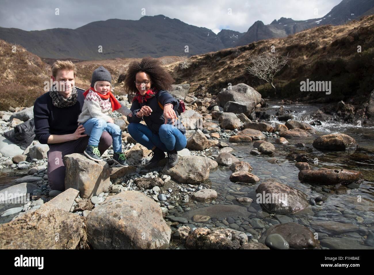 Family by stream, Fairy Pools, Isle of Skye, Hebrides, Scotland - Stock Image