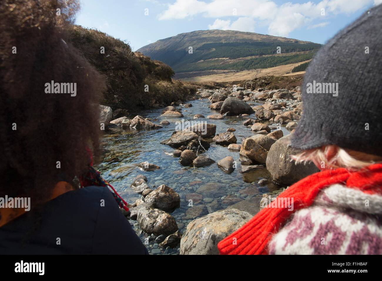 Woman and boy looking at view, Fairy Pools, Isle of Skye, Hebrides, Scotland - Stock Image