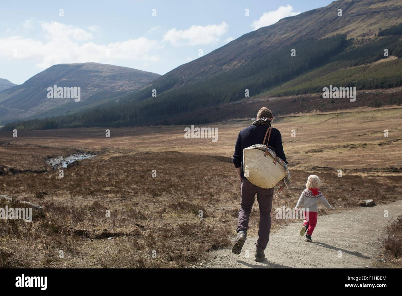 Father and son out hiking, Fairy Pools, Isle of Skye, Hebrides, Scotland - Stock Image