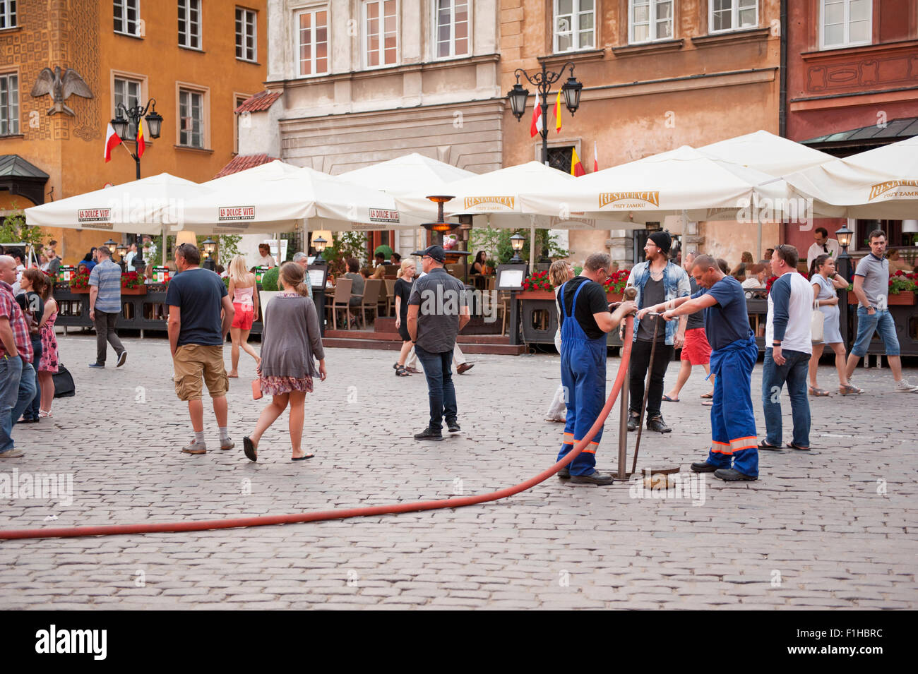 Workers shutting off water curtain hydrant - Stock Image