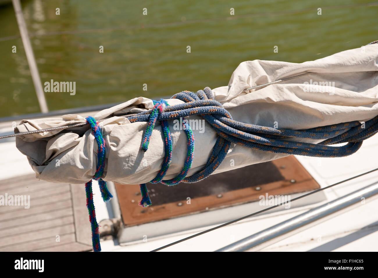 Rolled up mast sail cloth at Masuria - Stock Image