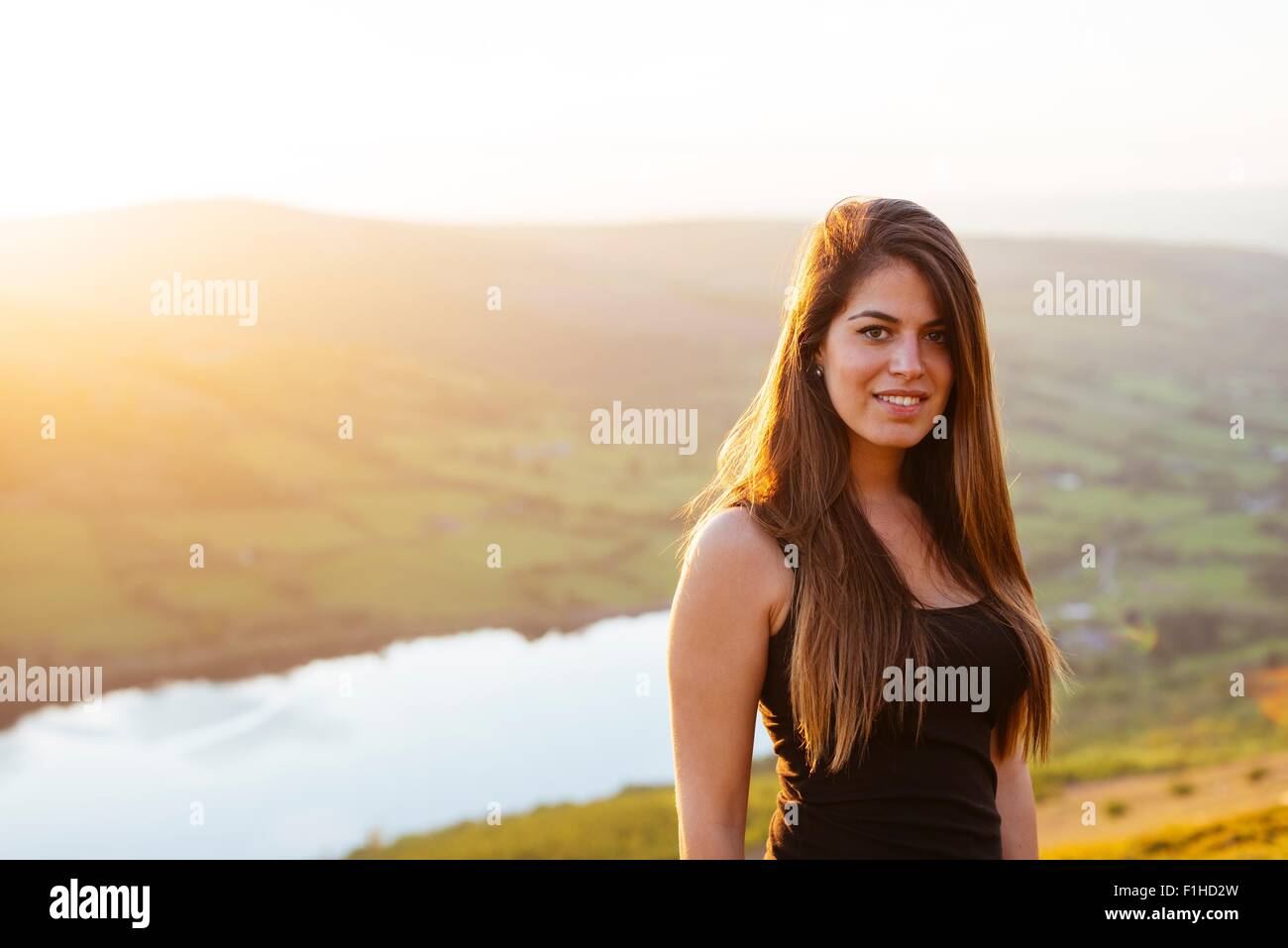 Portrait of young woman, Talybont Reservoir in Glyn Collwn valley, Brecon Beacons, Powys, Wales - Stock Image