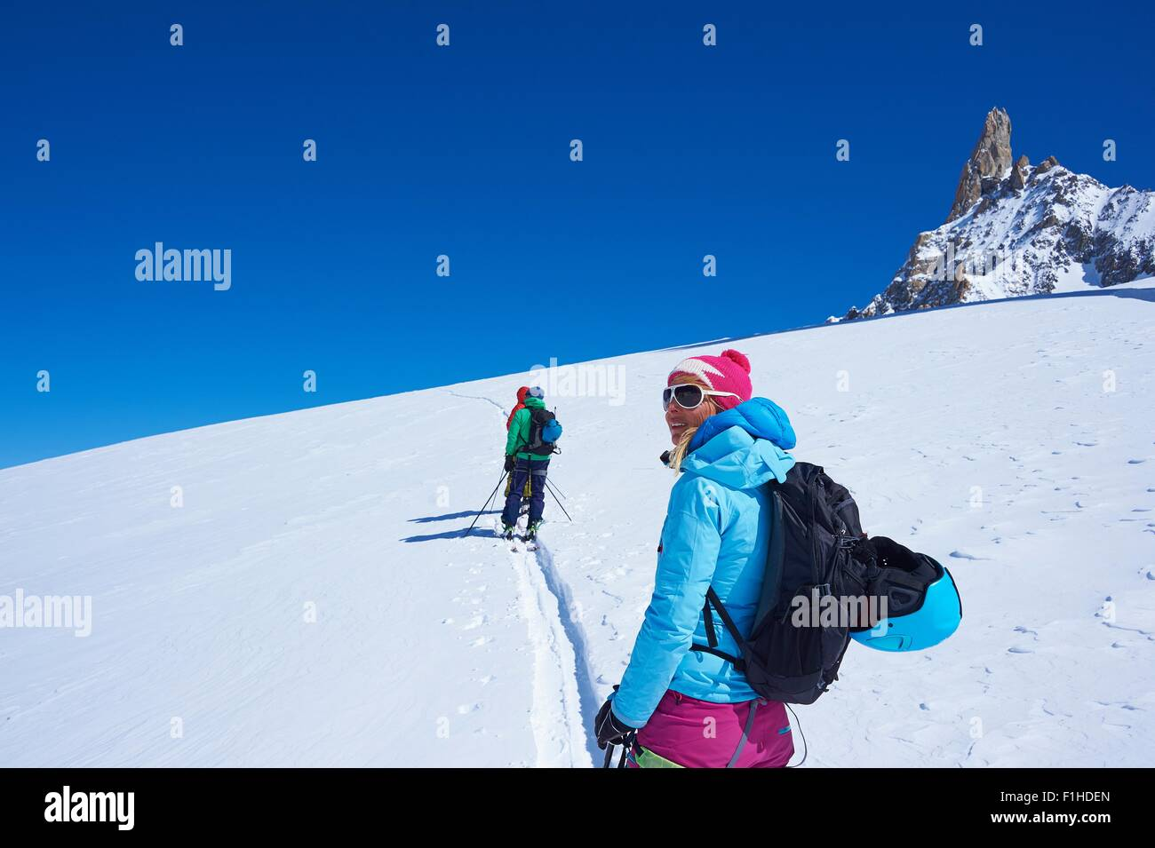 Mature female skier looking out from Mont Blanc massif, Graian Alps, France Stock Photo