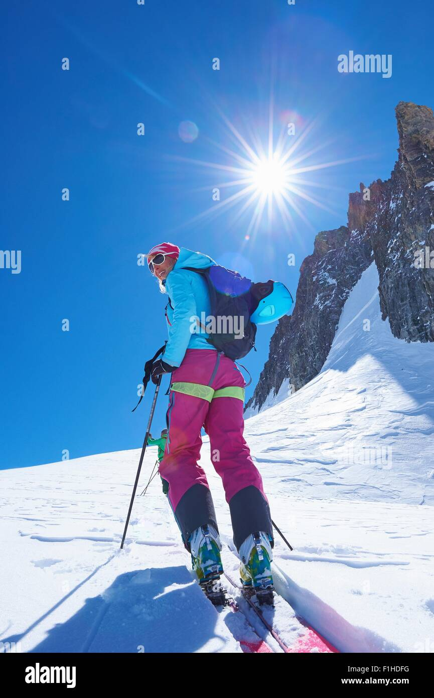Mature female skier moving up Mont Blanc massif, Graian Alps, France Stock Photo