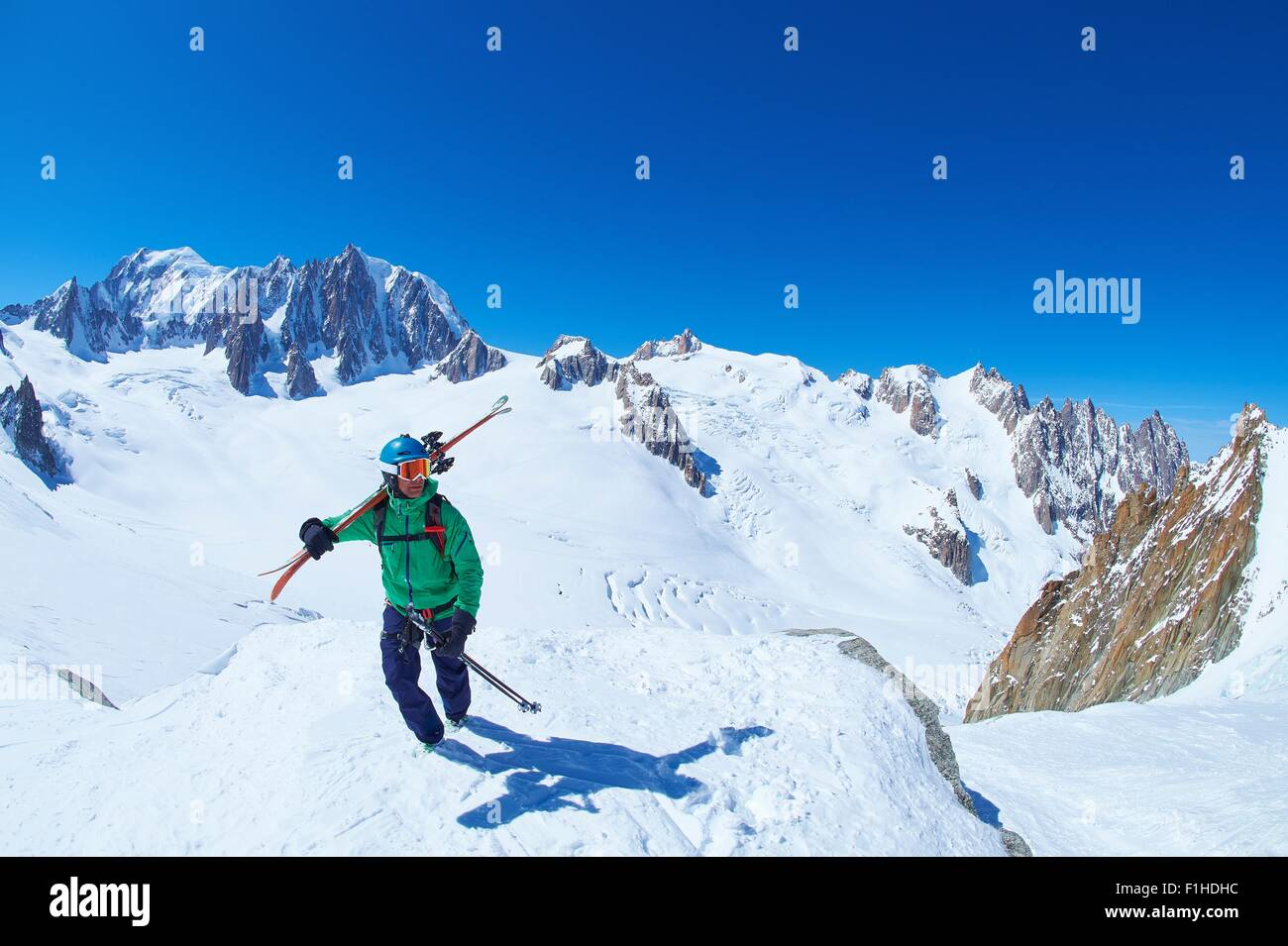 Mature male skier on ridge at Mont Blanc massif, Graian Alps, France - Stock Image