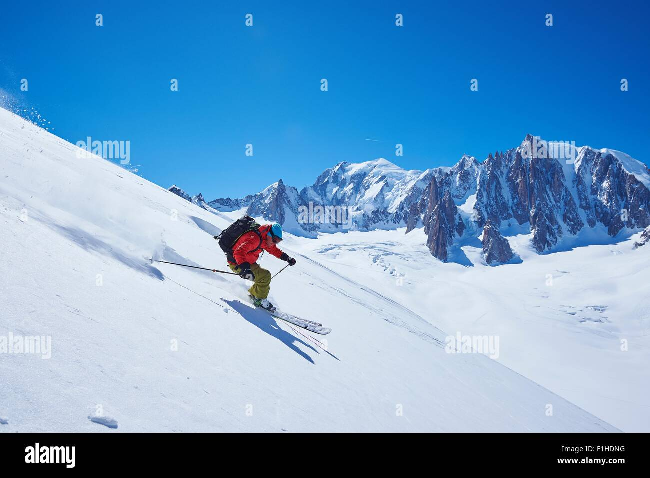 Male skier speeding downhill,  Mont Blanc massif, Graian Alps, France - Stock Image
