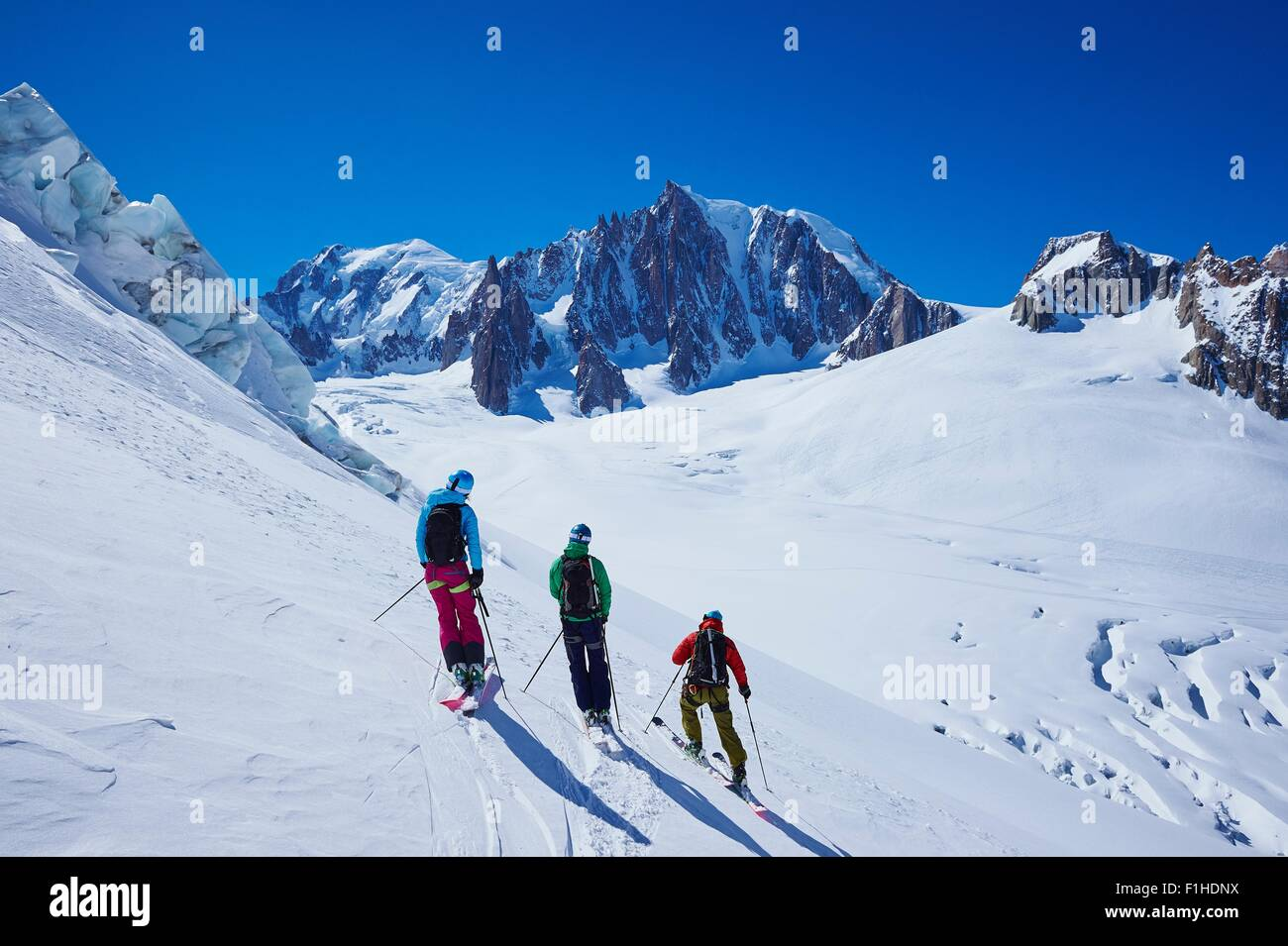 Three adult skiers side by side on Mont Blanc massif, Graian Alps, France - Stock Image