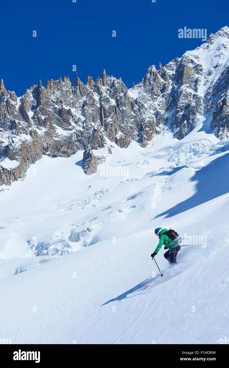 Male skier skiing steep downhill on Mont Blanc massif, Graian Alps, France - Stock Image