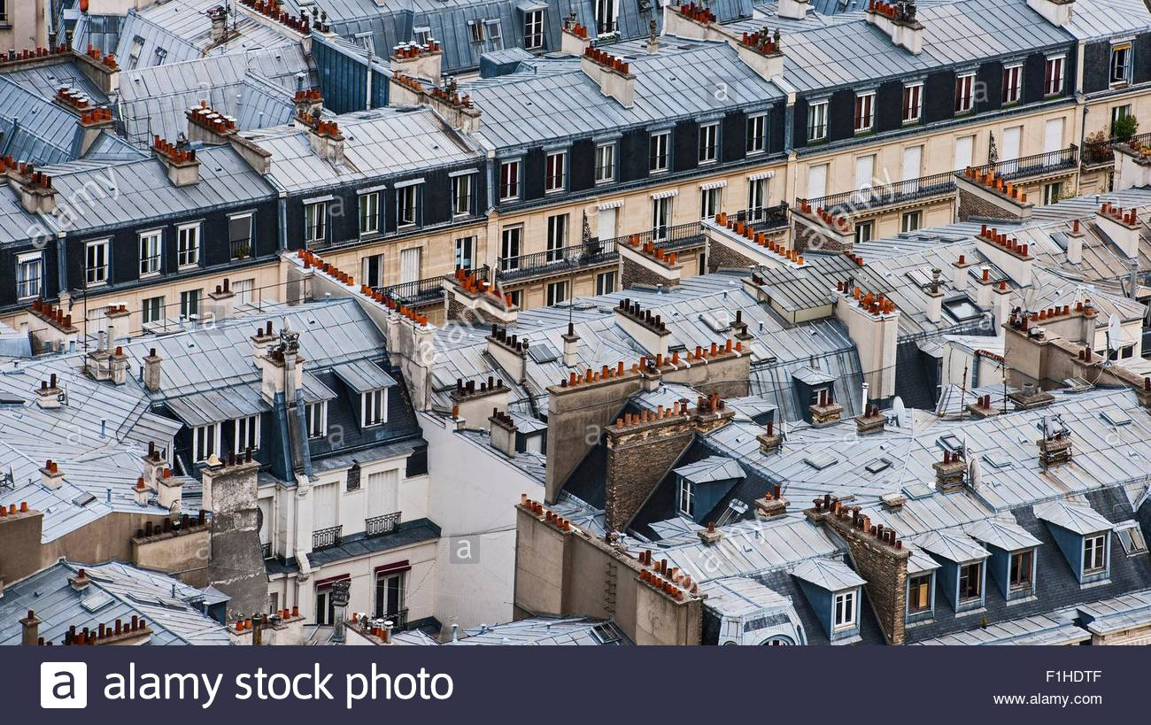 High angle view of rooftops and chimneys, Paris, France - Stock Image