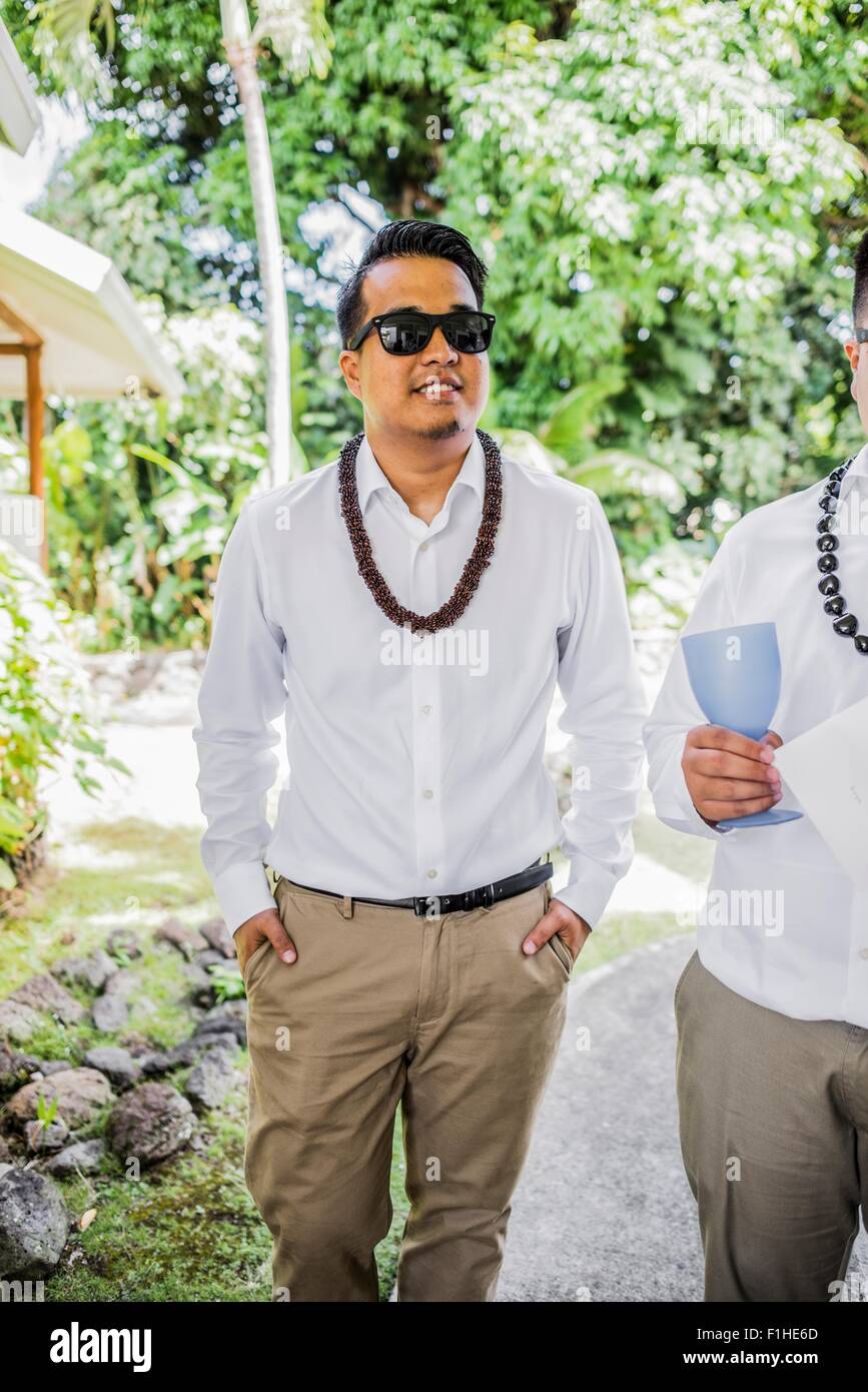 Bridegroom preparing for Hawaiian wedding wearing kukui nut beads, Kaaawa, Oahu, Hawaii, USA - Stock Image