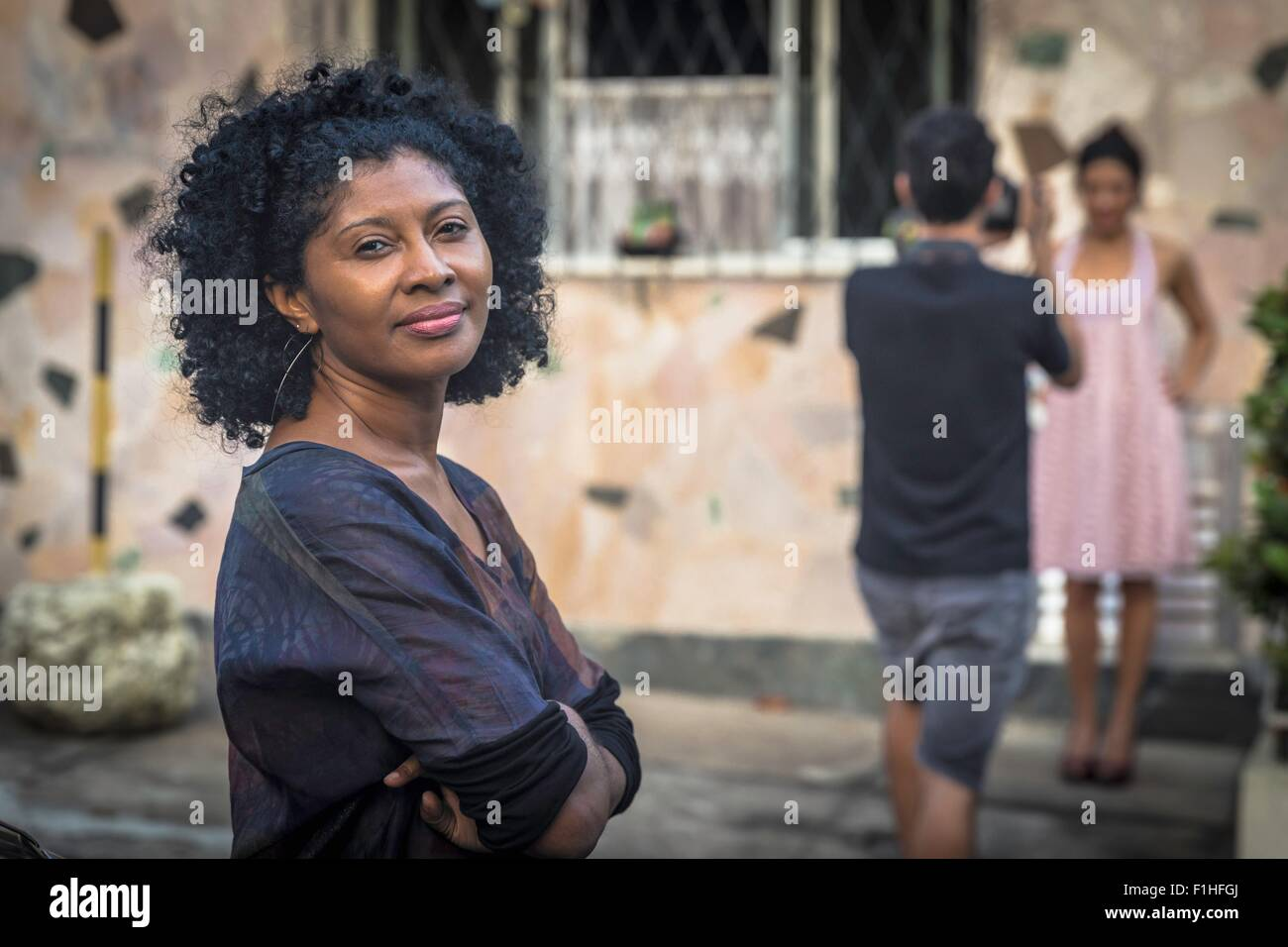 Portrait of fashion shoot assistant smiling and looking at camera - Stock Image