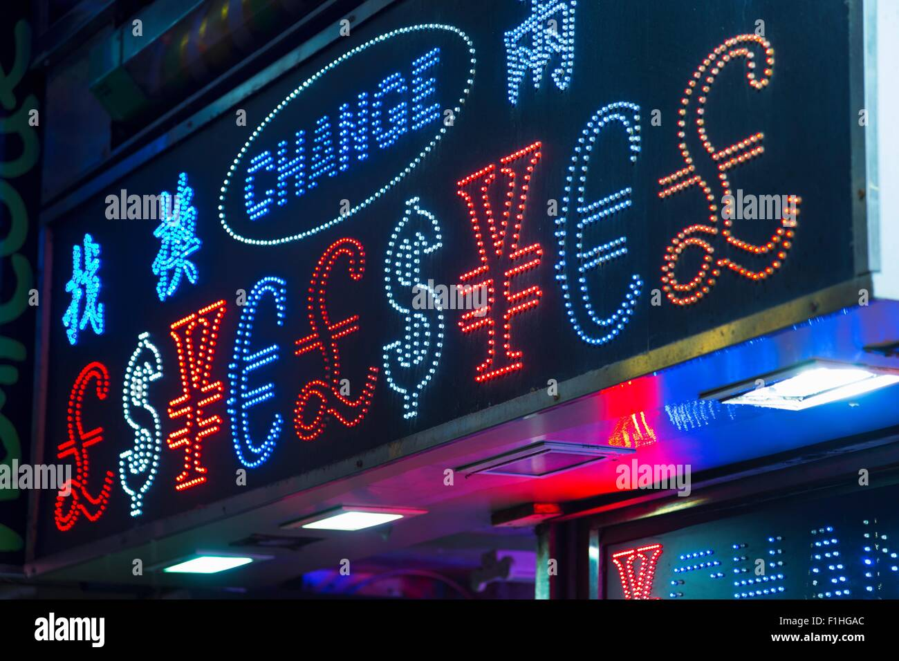 Illuminated currency exchange sign, Hong Kong, China - Stock Image
