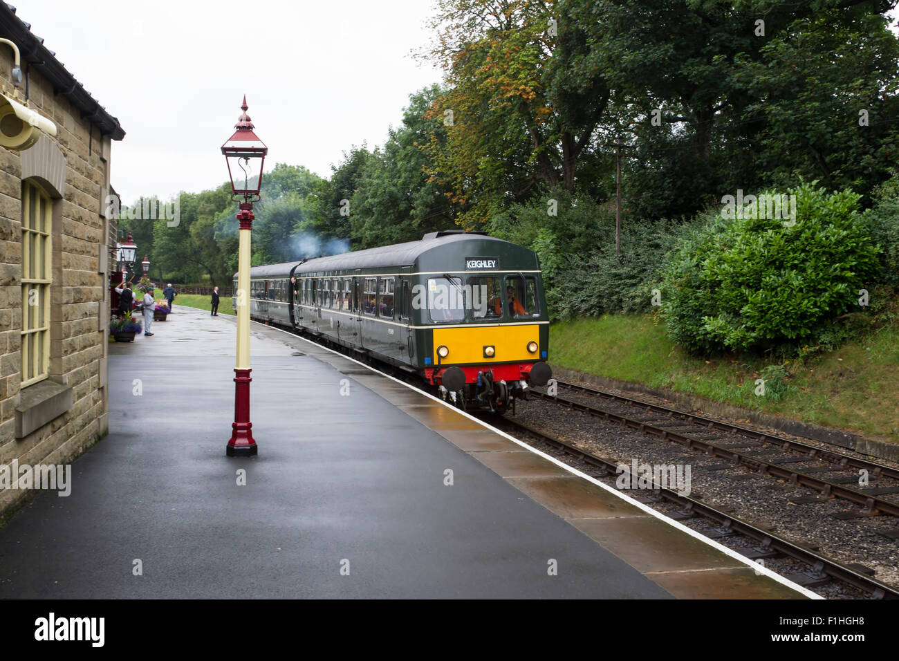 Diesel Multiple Unit DMU train departing Oxenhope on the Keighley and Worth Valley Heritage line. - Stock Image