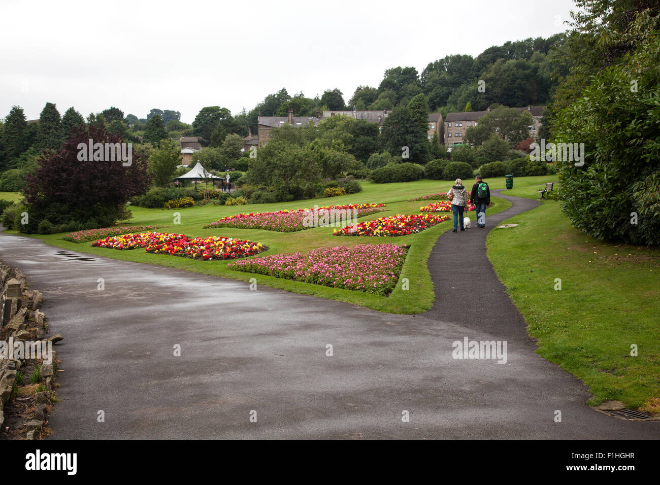 Late summer flowers on display in Haworth Central Park West Yorkshire a tourist attraction and area associated with - Stock Image