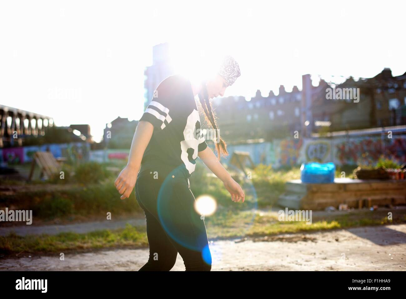 Young women dancing in the sunlight, backlit - Stock Image