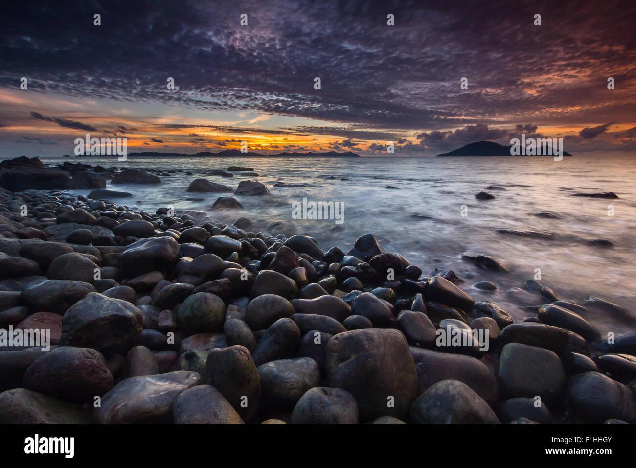 Sunset at a coast near Batu Payung Beach, West Kalimantan, Indonesia - Stock Image
