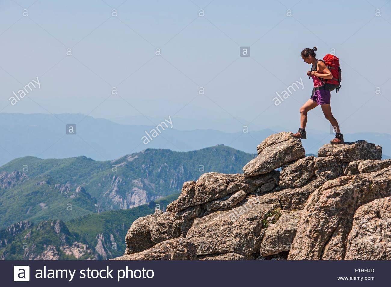 Female hiker stepping on ridge on way to Daecheongbong peak,  Seoraksan National Park in South Korea - Stock Image