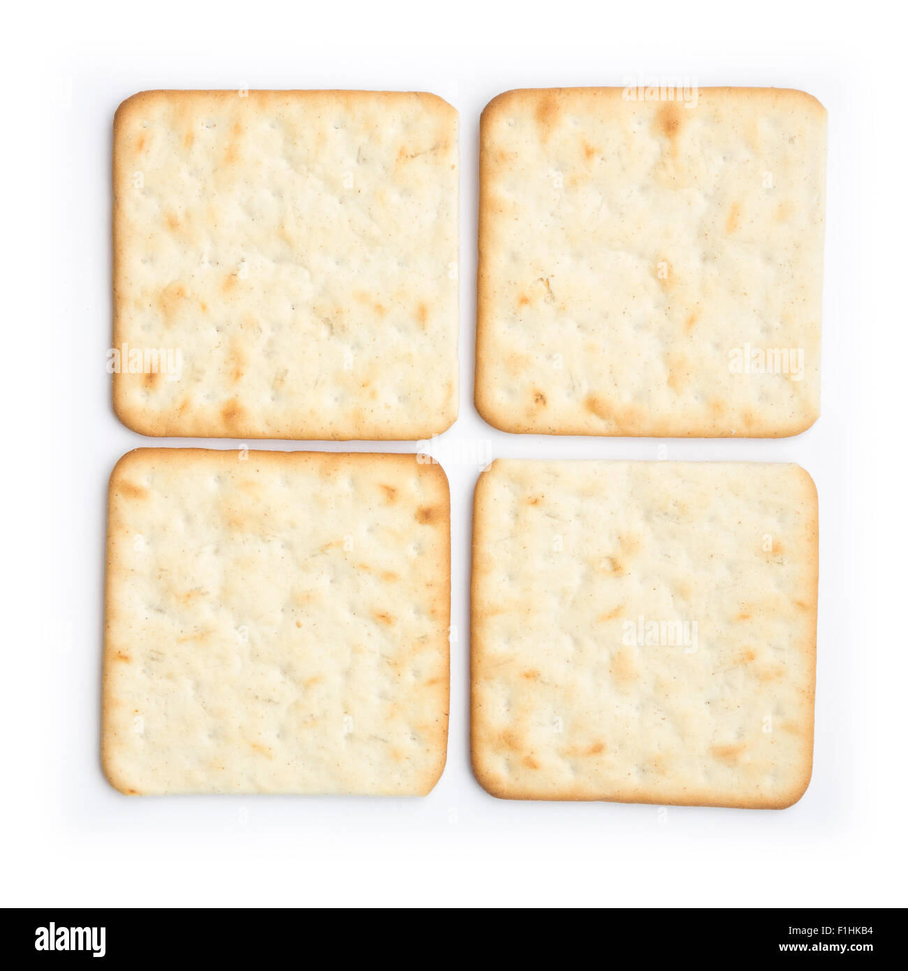 Cheese crackers or biscuits isolated on a white background. - Stock Image
