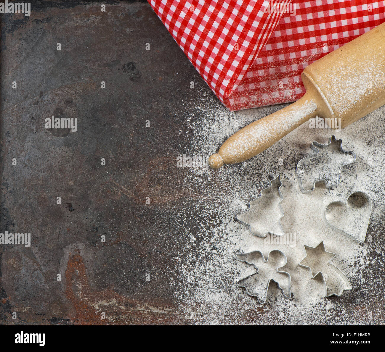 Flour, rolling pin and cookie cutters. Christmas food. Baking ingredients and tolls for dough preparation - Stock Image