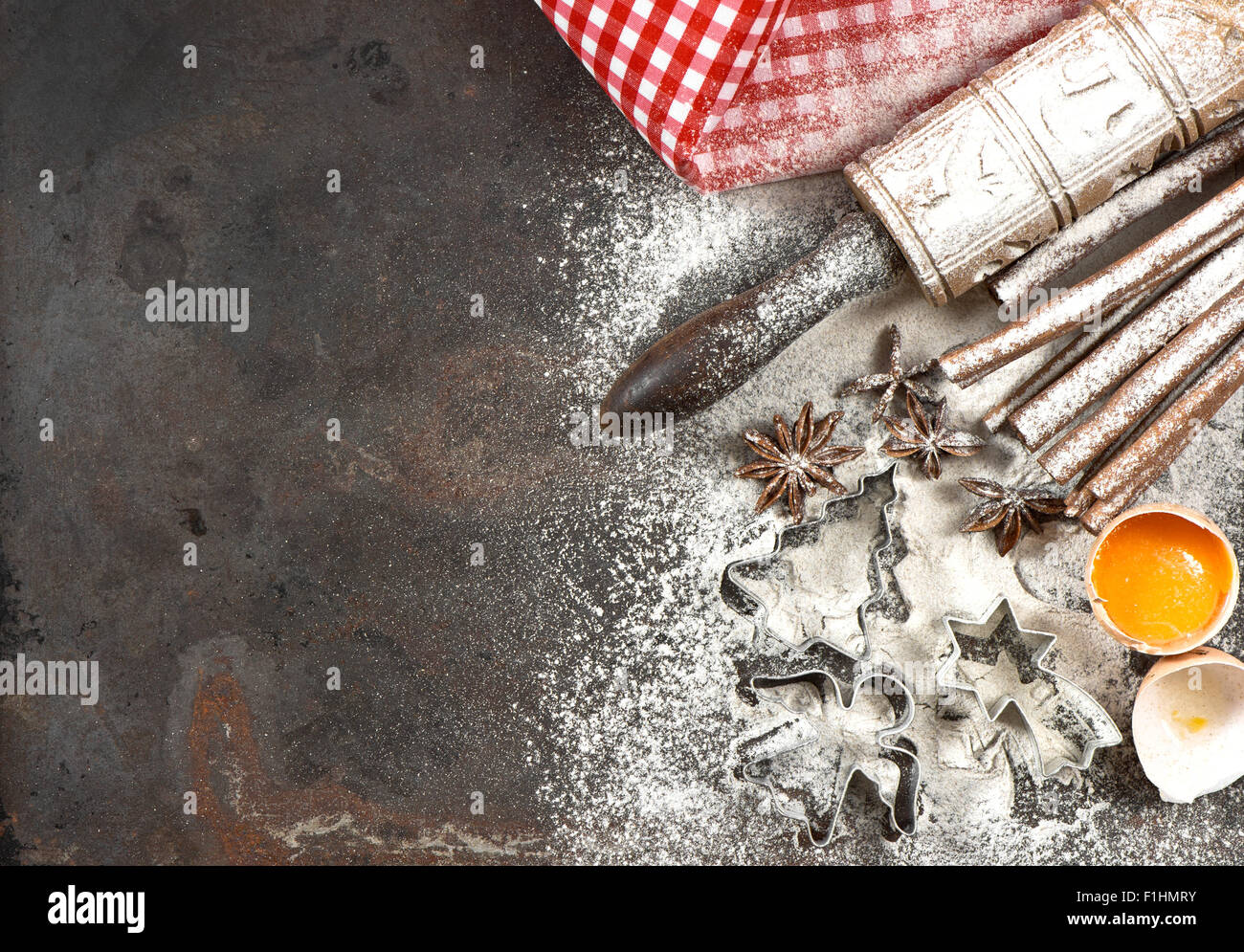 Christmas food. Baking ingredients, spices and tolls. Flour, eggs, rolling pin and cookie cutters - Stock Image