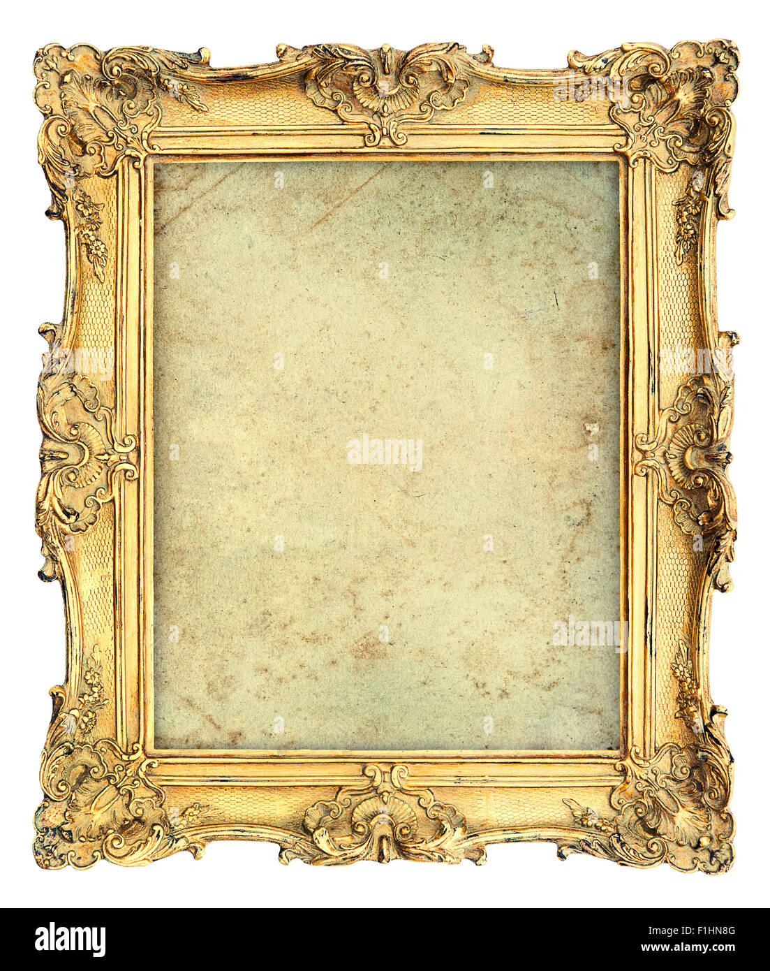 Golden baroque style picture frame with canvas isolated on white ...