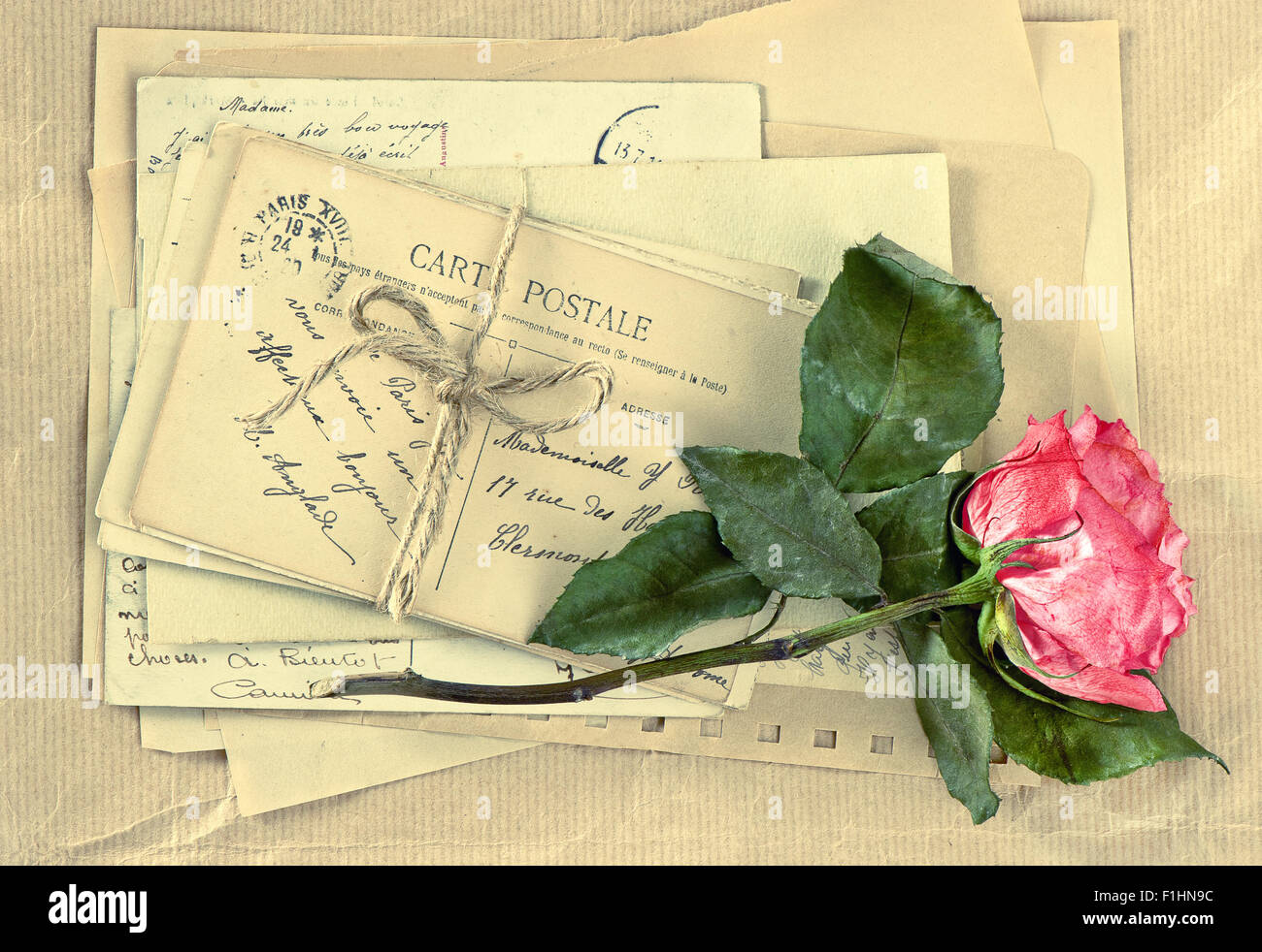 Old letters and dry rose flower. Vintage postcards and envelopes. Retro  style toned picture