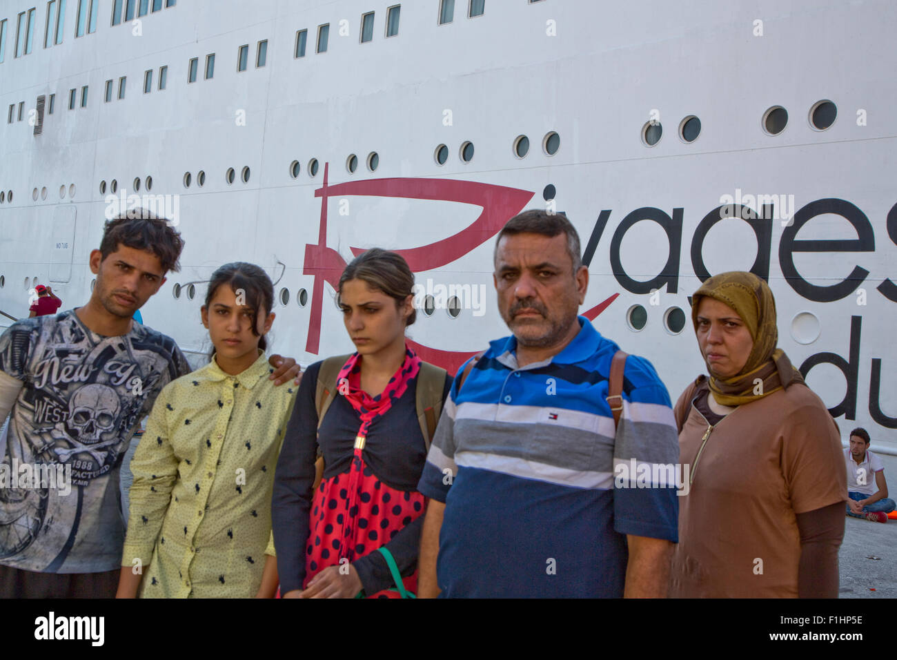 Symi Island, Dodecanese. 01st Sep, 2015. The family of Amir Mohammed Moklas who died in a shootout between people - Stock Image