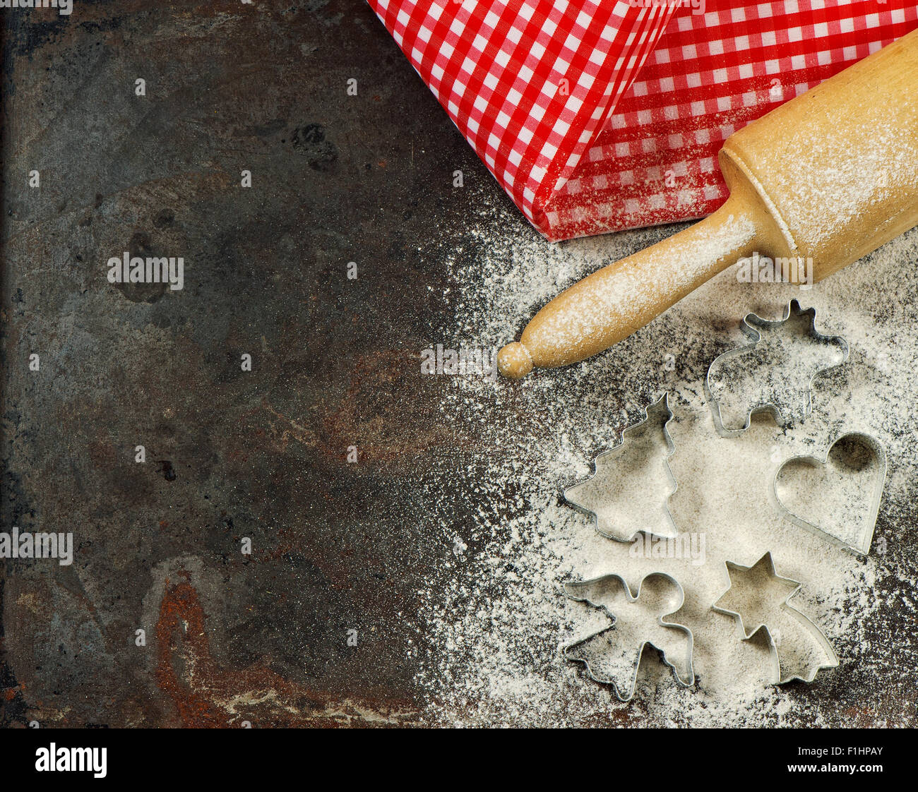 Flour, rolling pin and cookie cutters. Christmas food. Baking ingredients and tolls for dough preparation. - Stock Image