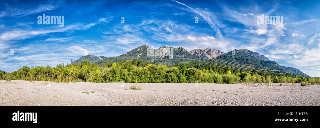 Banks of the River Isar in Bavaria, Germany with a view to the Karwendel mountains - Stock Image