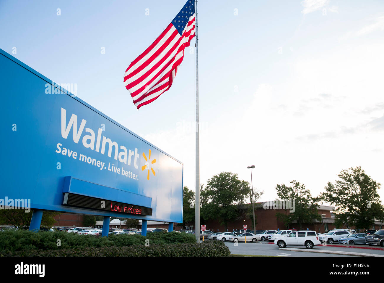 A logo sign outside of the Walmart headquarters, known as the Home Office in Bentonville, Arkansas on August 18, - Stock Image