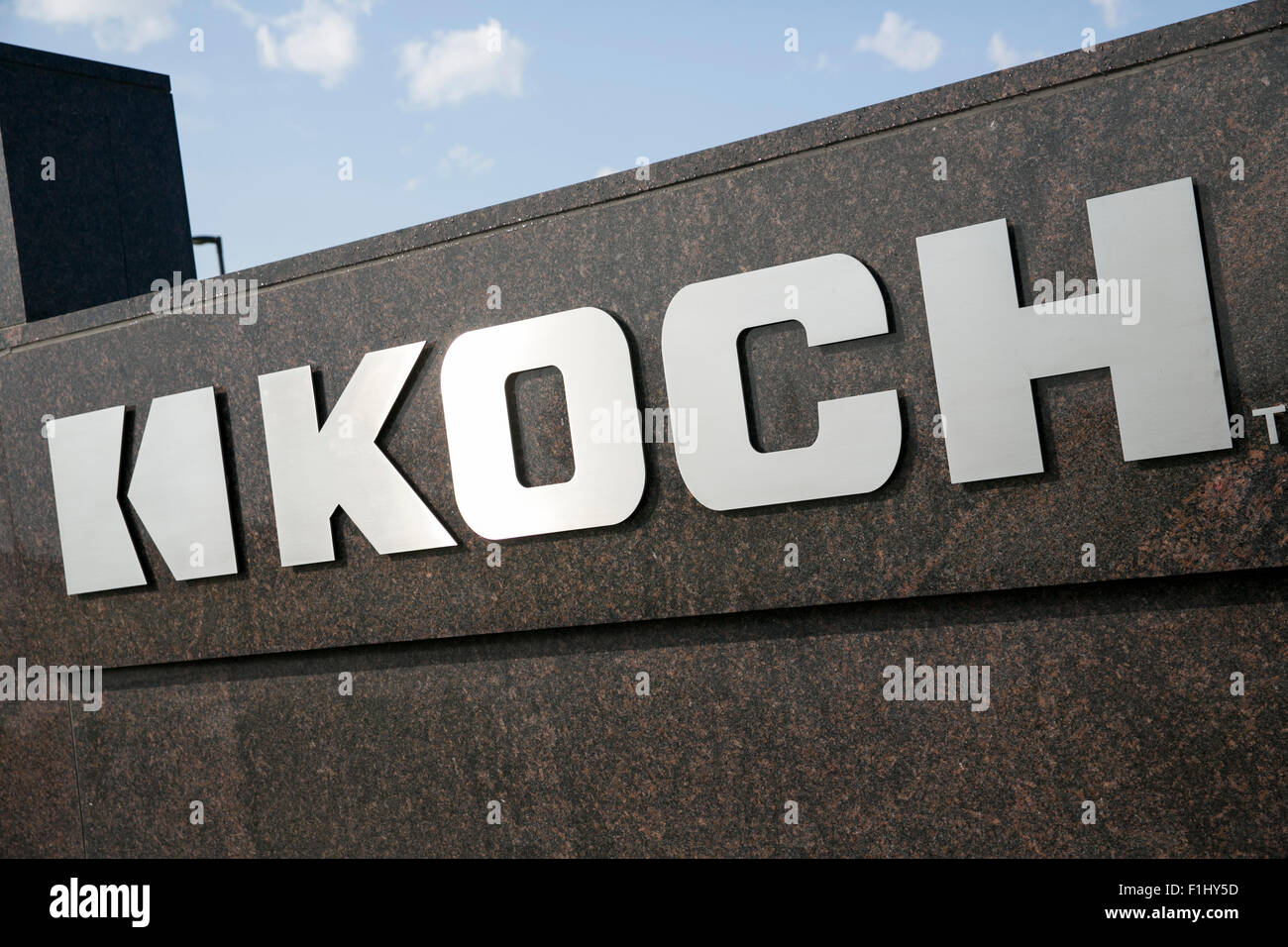A logo sign outside of the headquarters of Koch Industries, Inc., in Wichita, Kansas, on August 22, 2015. - Stock Image