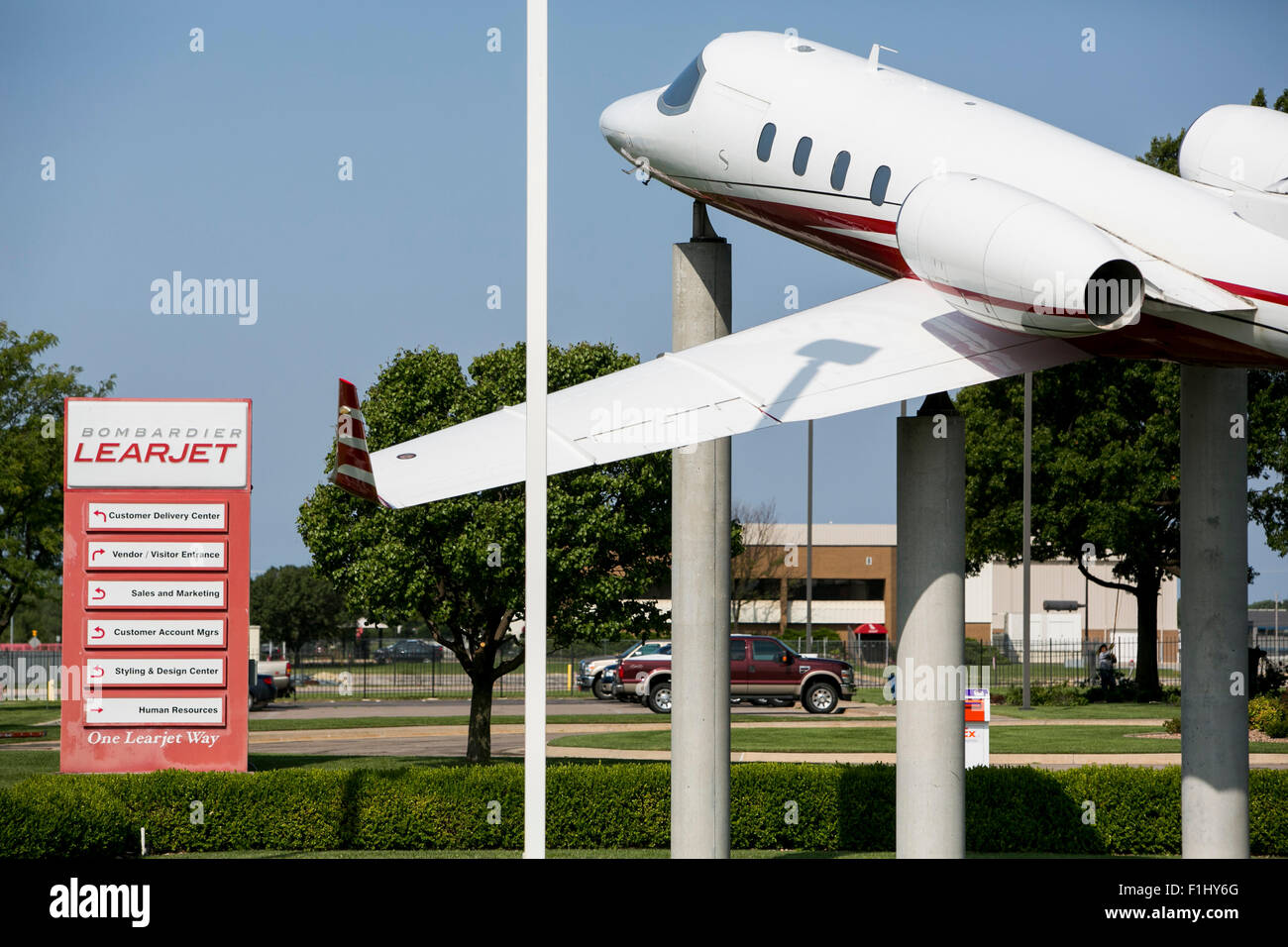 A logo sign outside of the headquarters of the Bombardier Learjet Corporation in Wichita, Kansas, on August 22, - Stock Image