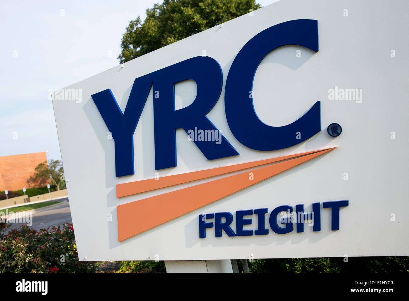 A logo sign outside of the headquarters of YRC Worldwide