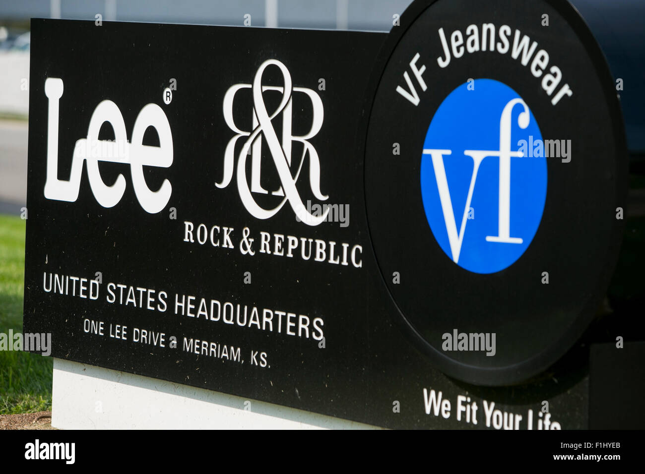 A logo sign outside the headquarters of Lee Jeans, a division of the VF Corporation in Merriam, Kansas on August - Stock Image