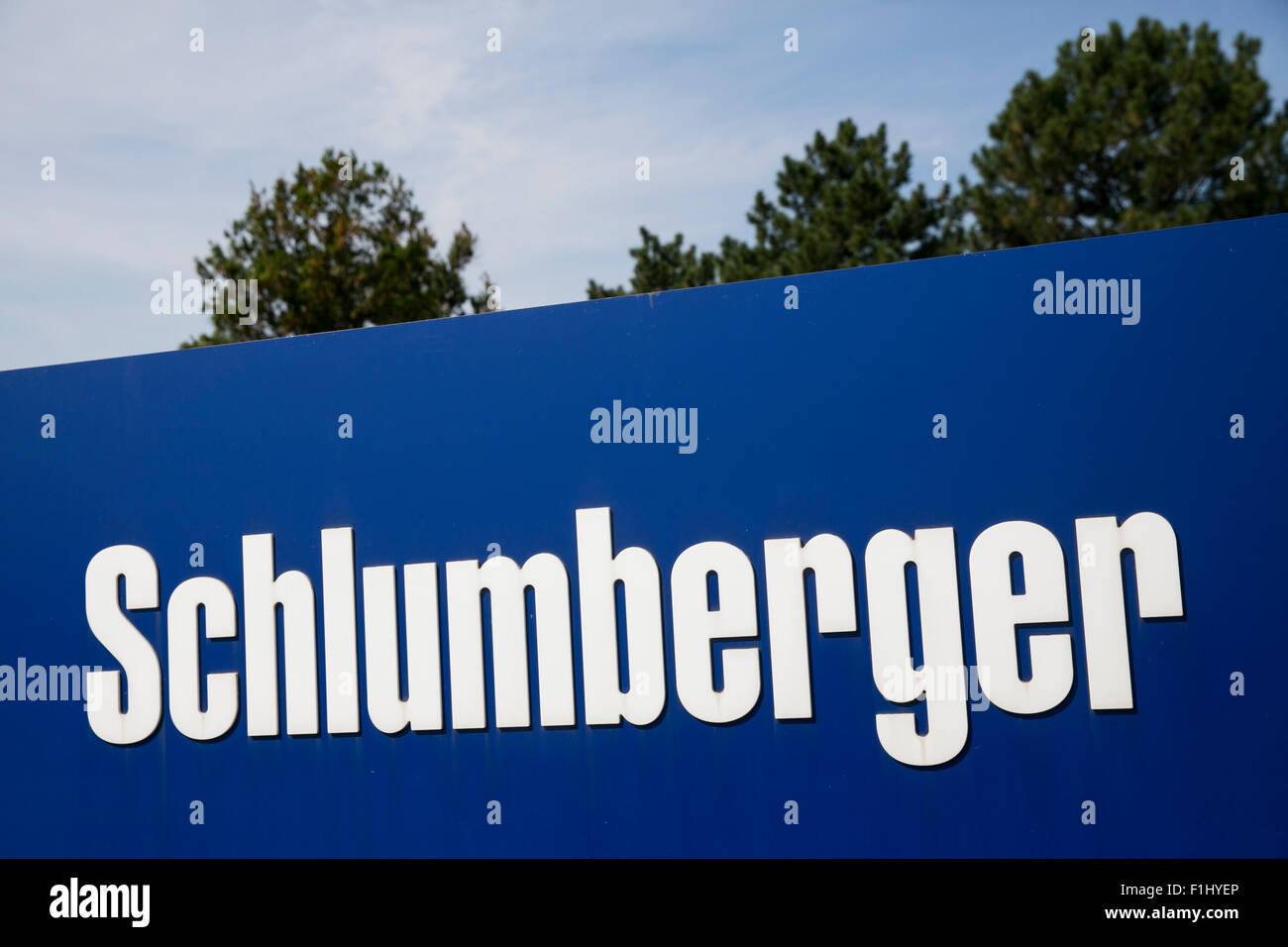 A logo sign outside of a facility operated by Schlumberger