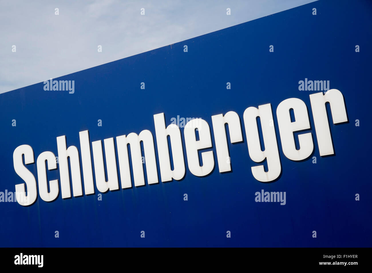 A logo sign outside of a facility operated by Schlumberger Limited, in Lawrence, Kansas, on August 23, 2015. - Stock Image
