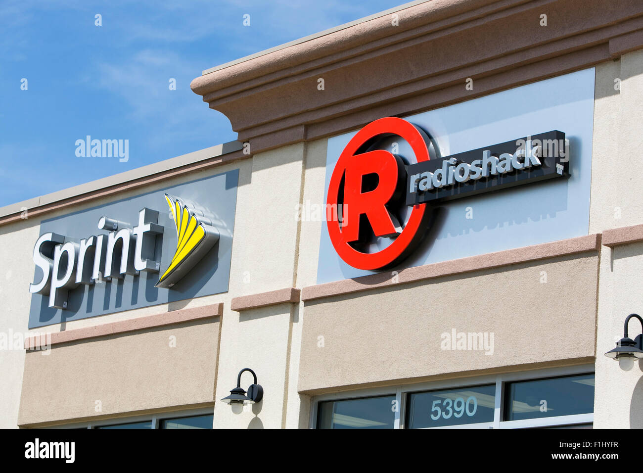 A logo sign outside of a joint Sprint and Radioshack store in Kansas City, Kansas on August 23, 2015. - Stock Image
